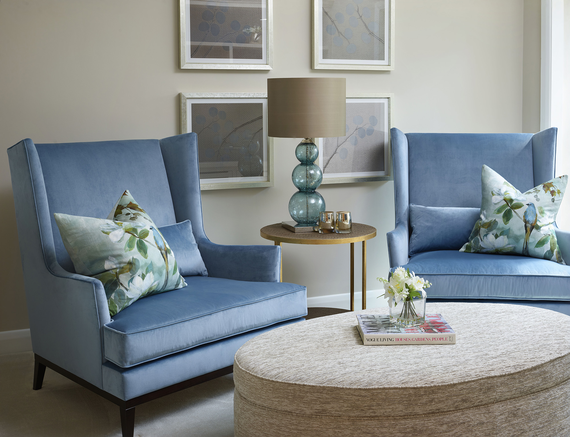 Blue Armchairs and Fabric Covered Coffee Table
